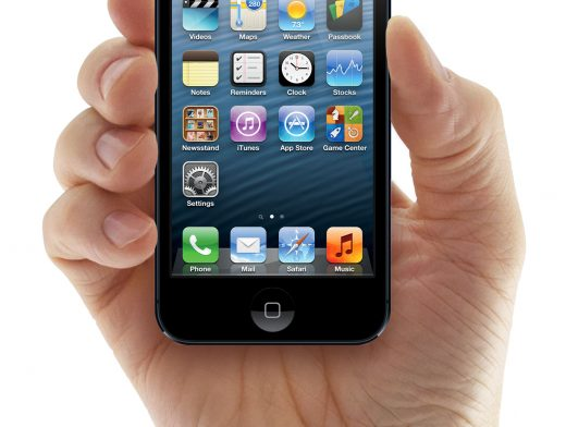 PSD Mockup Of Male Hands Holding iPhone 5