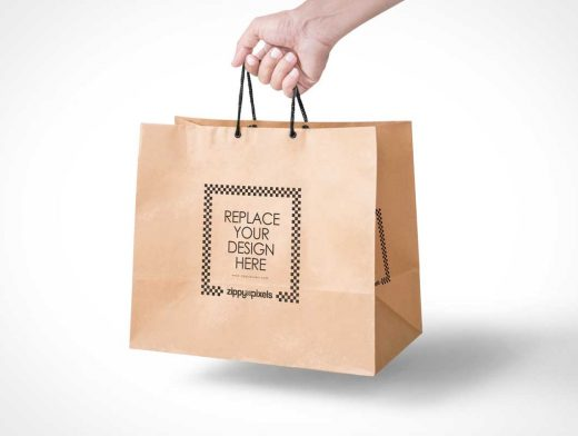 Free Paper Bag PSD Mockup In Handheld View
