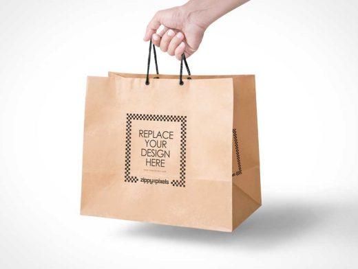 Free Paper Bag PSD Mockup In Handheld View