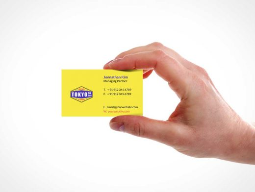 Hand Holding Business Card PSD Mockup