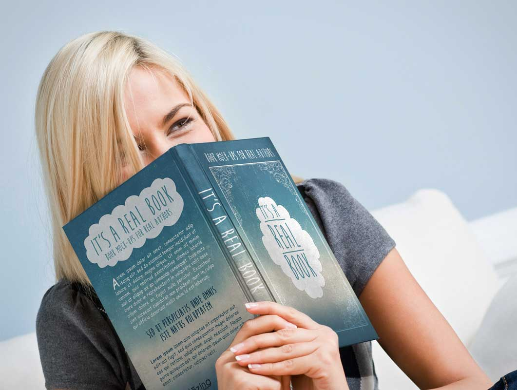 Woman Enjoying Reading Hardcover PSD Mockup