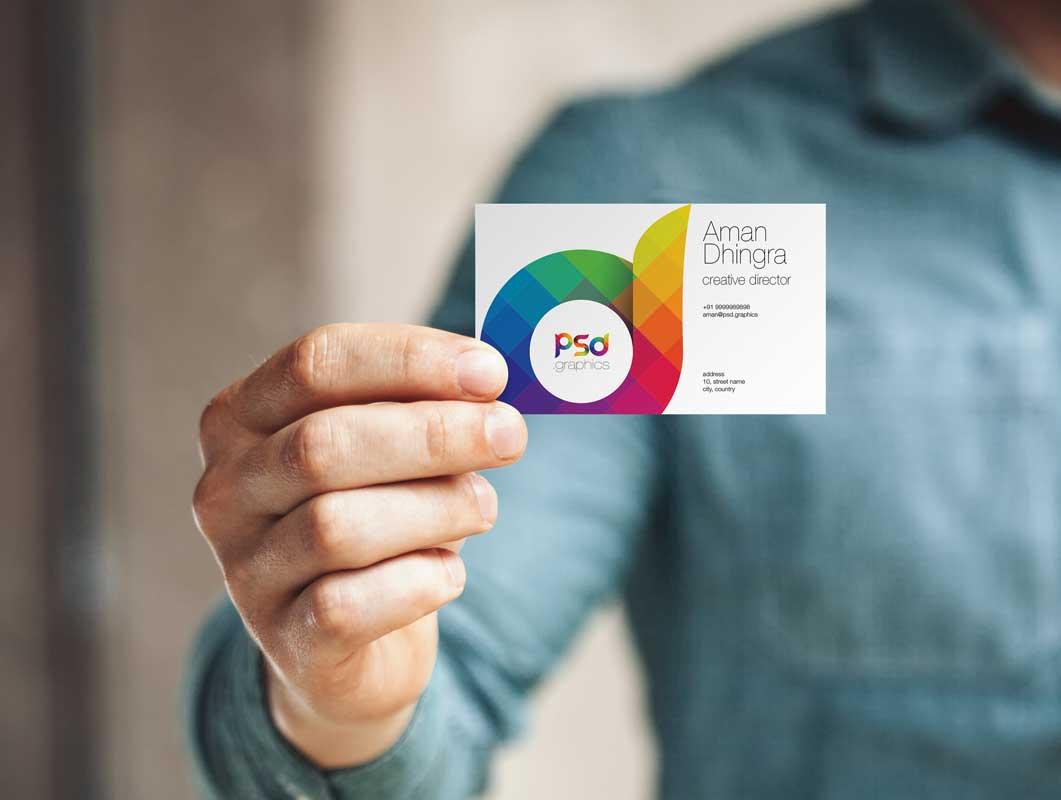 Man Holding Business Card PSD Mockup