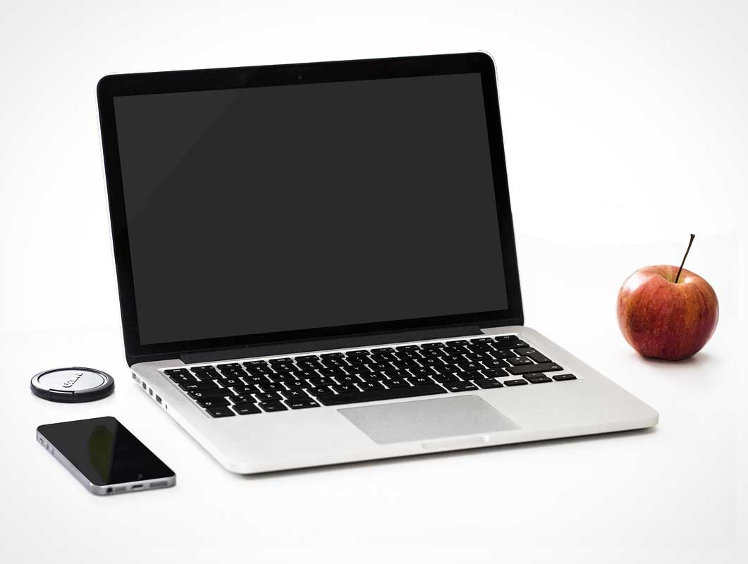 Macbook Pro PSD Mockup With iPhone and Camera Lens Cap Scene