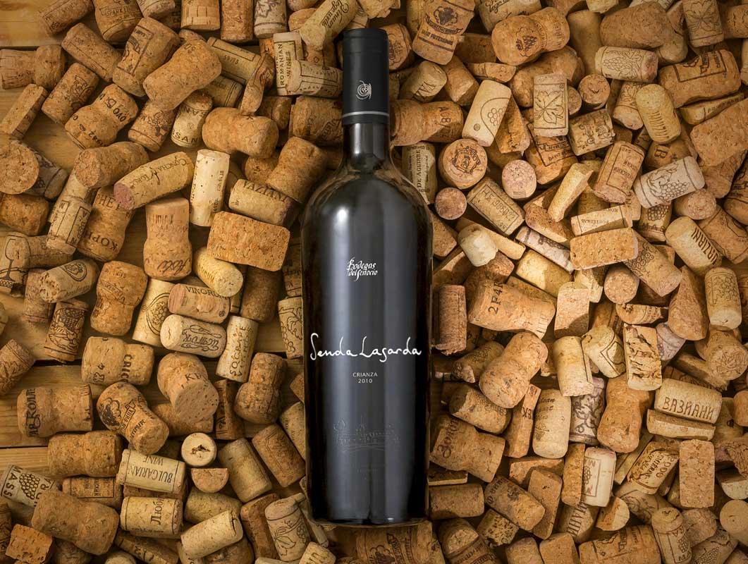 Realistic Wine Bottle PSD Mockup On Cork Pile