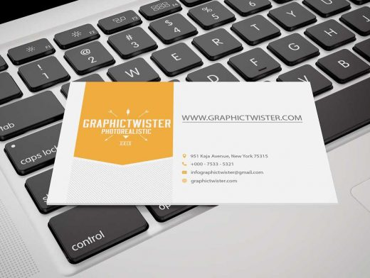 Business Card Laying On Keyboard PSD Mockup