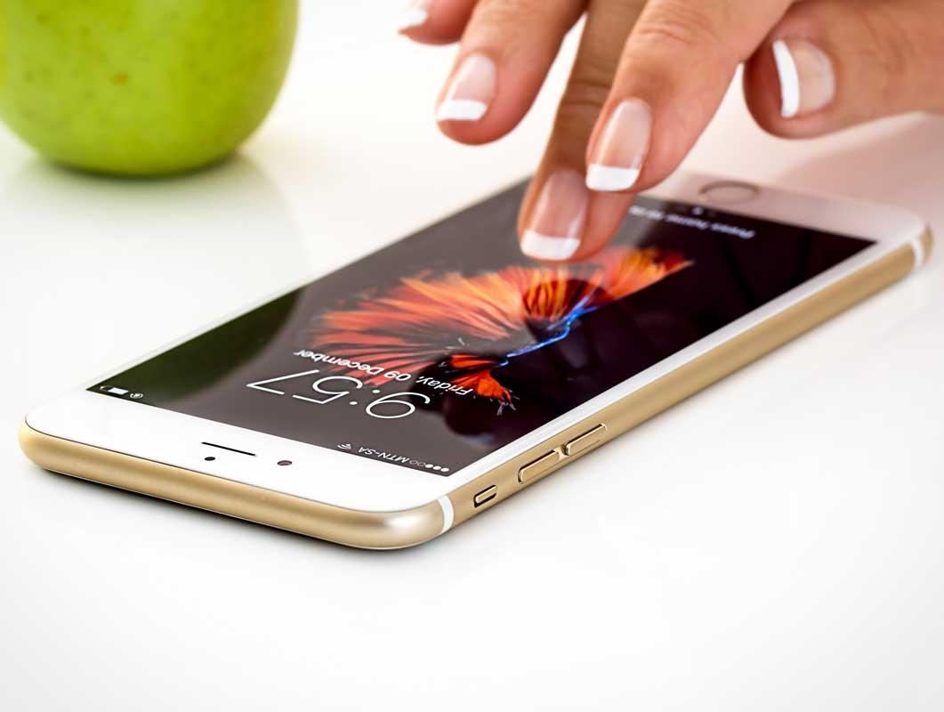 Gold iPhone 7 Plus Female Hand PSD Mockup