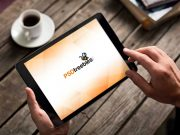 Photorealistic iPad In Male Hands PSD Mockup