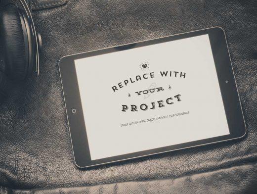 iPad & Headphones Over Leather Bag PSD Mockup