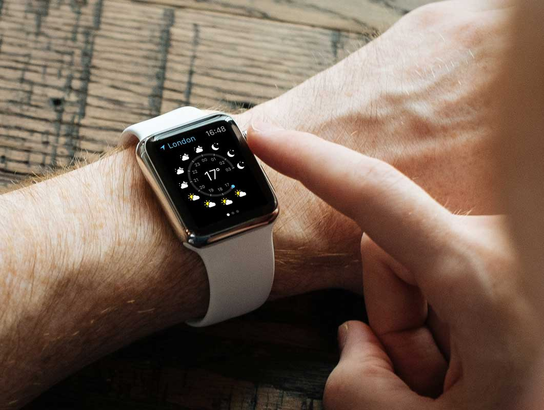 Apple Watch With White Wrist Band In Action PSD Mockup