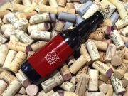 Beer Bottle On Bed of Wine Corks PSD Mockup