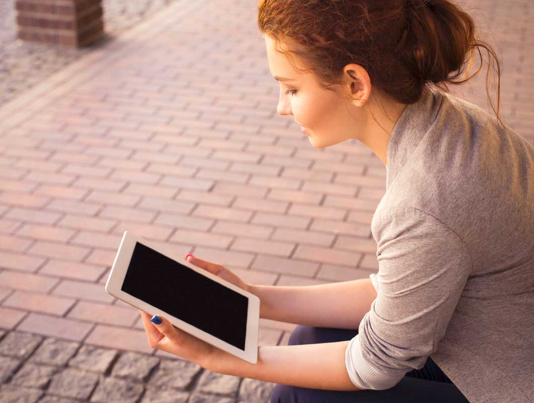 Young Woman Viewing iPad Photo