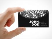 Business Card Front Held In Hand PSD Mockup