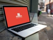 MacBook Laptop & Bokeh Street Background PSD Mockup