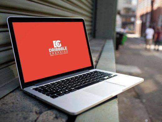 MacBook Laptop & Bokeh Street Background PSD Mockup