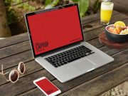 MacBook & Smartphone Outdoor Workspace PSD Mockup