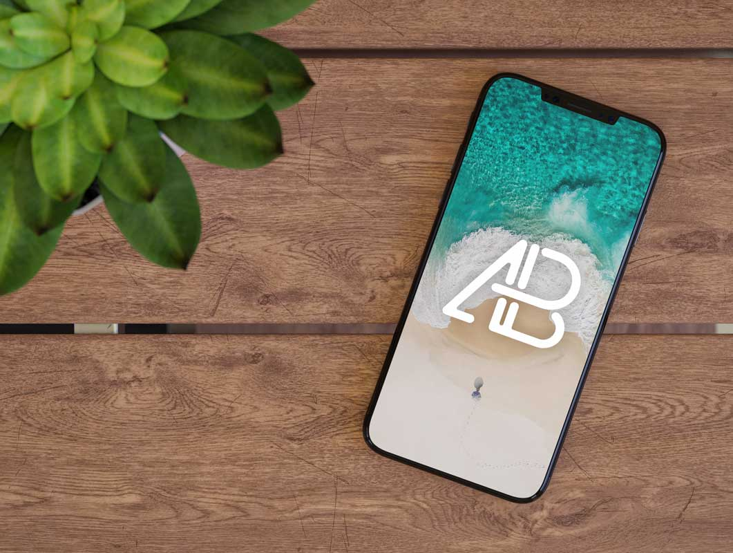 iPhone 8 Smartphone Face Up on Table PSD Mockups
