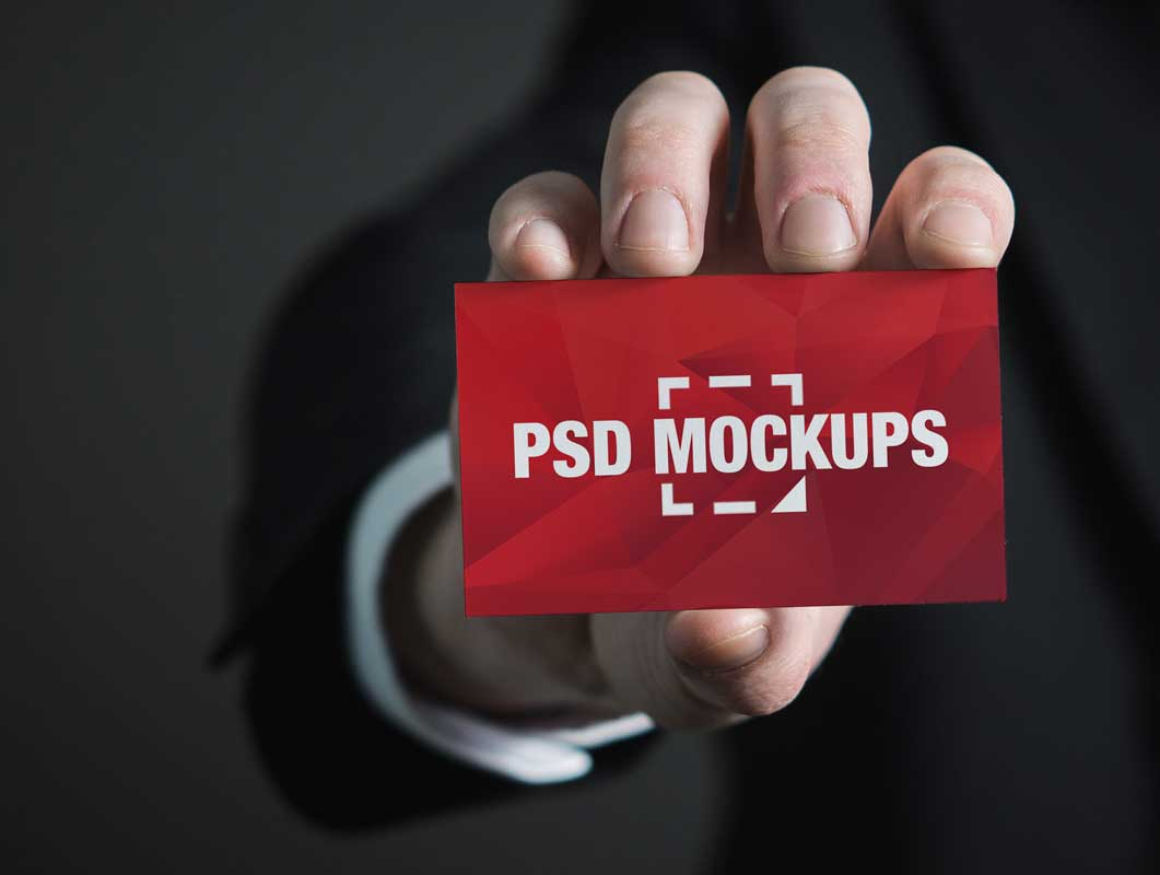 Business Card In Hand Front Face PSD Mockup