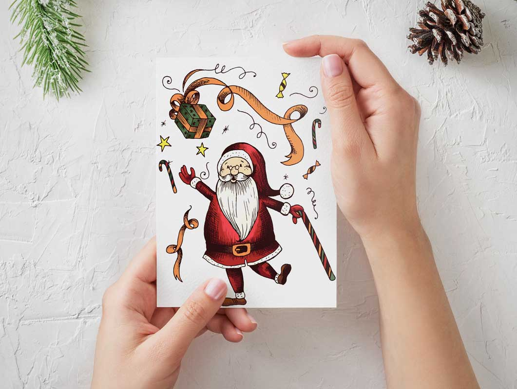 Hand-Held Seasons Greeting Card Portrait Mode PSD Mockup