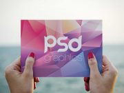 Woman Holding Postcard To The Horizon PSD Mockup