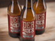 Brown Longneck Glass Beer Bottle Label Closeup PSD Mockup