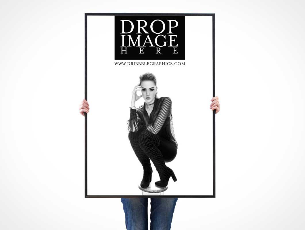 Woman Holding Portrait Framed Poster Front PSD Mockup