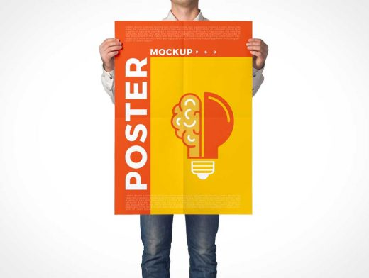 Man Holding Unfolded Portrait Poster PSD Mockup