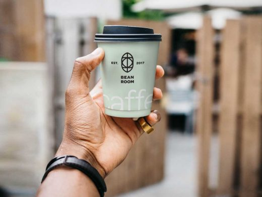Man Holding Paper Coffee Cup PSD Mockup