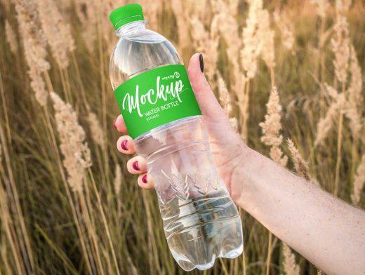 1L Plastic Water Bottle In Hand PSD Mockup