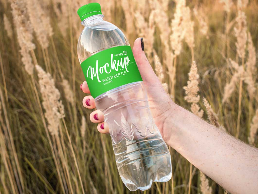 1L Plastic Water Bottle In Hand PSD Mockup