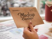 Recycled Paper Envelope in Hand PSD Mockup