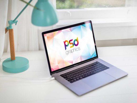 MacBook Pro Laptop on Table PSD Mockup